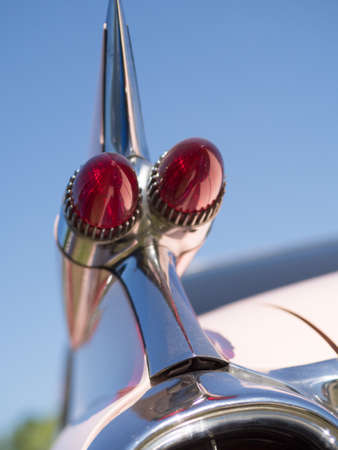 Close up of a big taillight on a blue summer sky, selective focus Stock Photo
