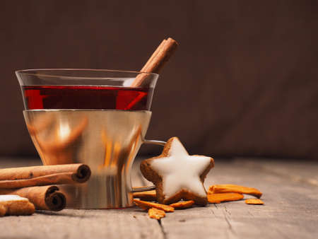 Mulled wine in a glass with cinnamon and star anise, Seasonal background