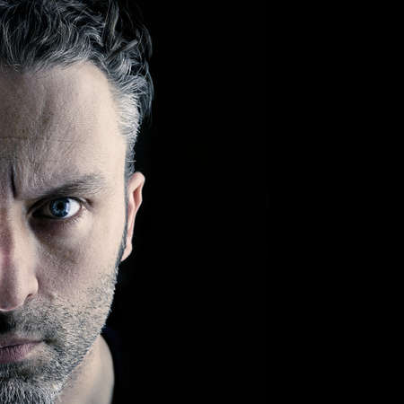 Sceptical man on a black background with space for text