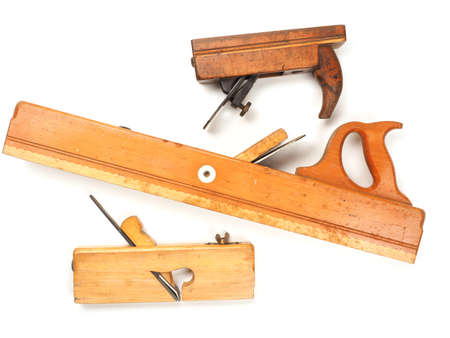 Three old used wood plane on a white background, traditional wood working tools