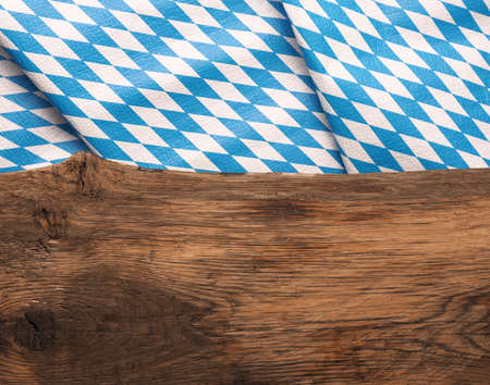 Old wooden oak plank with the Bavarian flag using as background, Oktoberfest or beer garden background Stock Photo