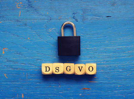 DSGVO concept image with small wooden dices on a wooden background Stock Photo