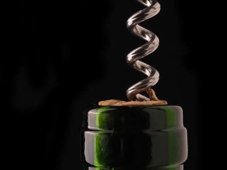 Close uo of a wine bottle with bottle opener on a dark background Reklamní fotografie