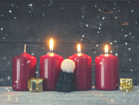 Four red Advent candles on a rustic wooden background Stok Fotoğraf
