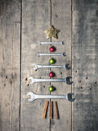Christmas tree shape with wrenches on a old rustic wood