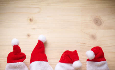 Santa hats on a wooden background