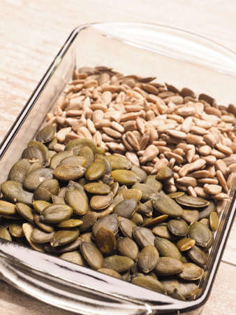 Close up of organic pumpkin and sunflower seeds in a glass bowl, healthy food concept Zdjęcie Seryjne