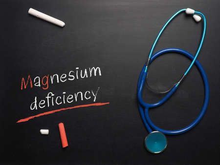 Blackboard with the words Magnesium deficiency and a stethoscope, medical or health care concept