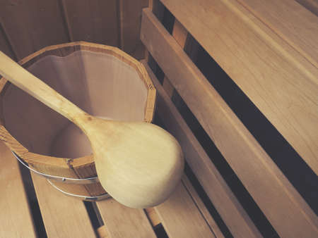 Water bucket with a wooden spoon in a sauna, wellness or health care concept Reklamní fotografie