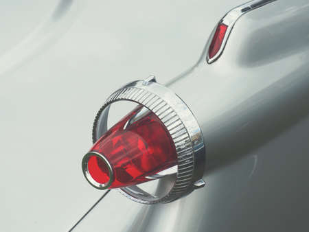 Close up of a rear lamp of an old vintage car, vintage color stylized