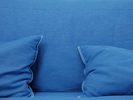 Blue couch with blue pillows close up shot, conceptual interior background