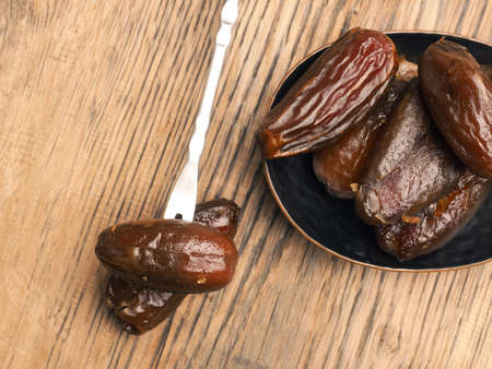 Sweet organic dried dates on a rustic wooden table