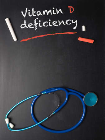 Blackboard with the words Vitamin D deficiency and a stethoscope, medical or health care concept