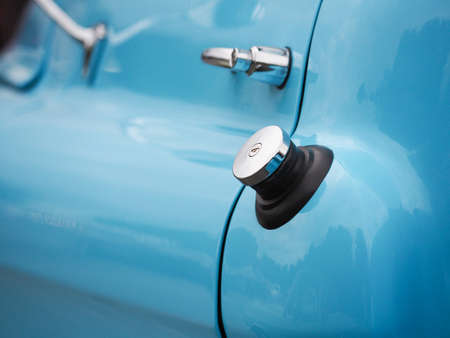 Filler cap of a blue old vintage truck, Conceptual image about gas mileage or energy waste