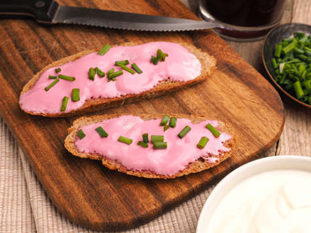 Organic curd with beetroot on a tasty whole grain bread, super food breakfast concept Stock Photo