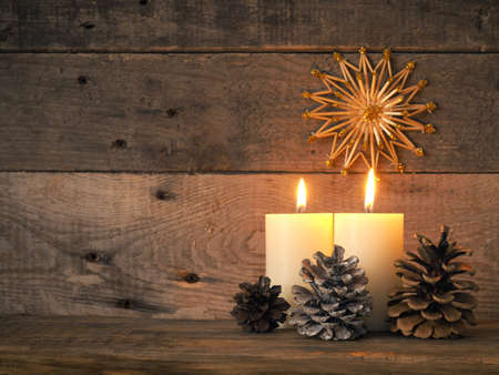 Two Advent candles are burning, the second Advent candle burns, Christmas concept