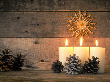 Three Advent candles are burning, third Advent Christmas concept