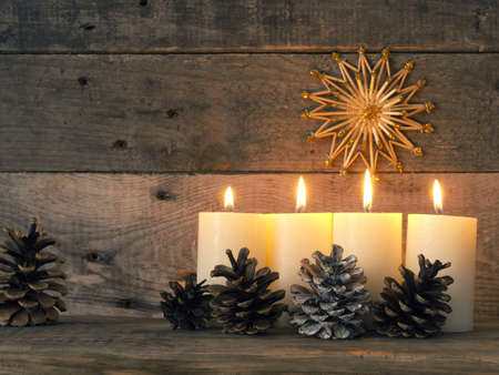 Four Advent candles are burning, fourth Advent candle burns, Christmas concept Stock fotó