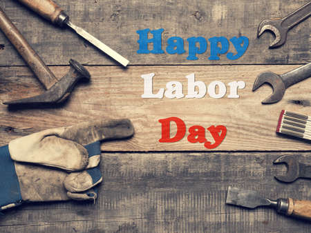 Old used tools on a workbench, Happy Labor Day concept Stock Photo