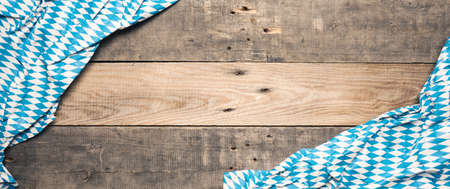 Bavarian flag on a rustic wooden background with space for text or image