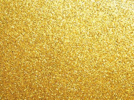 Golden glittering background using as festive background with space for text or image