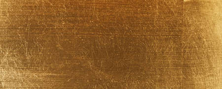 In gold painted wood texture using as luxury or festive background