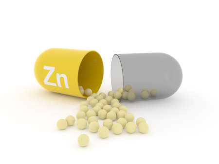 Open capsule with Zn zinc on a white table, food supplement concept, 3d rendering