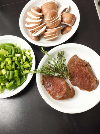 Filet steak of red deer with ingredients in a kitchen, view from above Reklamní fotografie