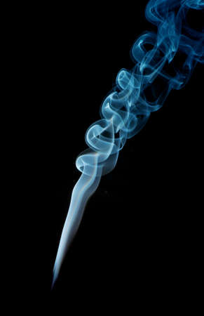 Abstract smoke in blue on a black studio background