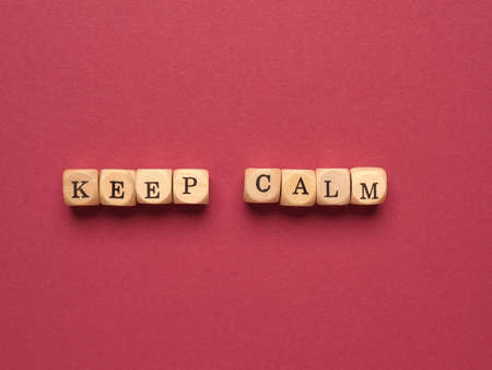 Small wooden blocks with the inscription Keep calm, positive mindset concept Zdjęcie Seryjne
