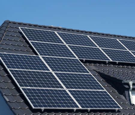 Solar panels on a roof, alternative energy, zero emission, sun power