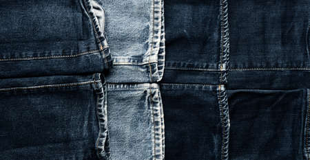 Panoramic texture of old used jeans using as header or background