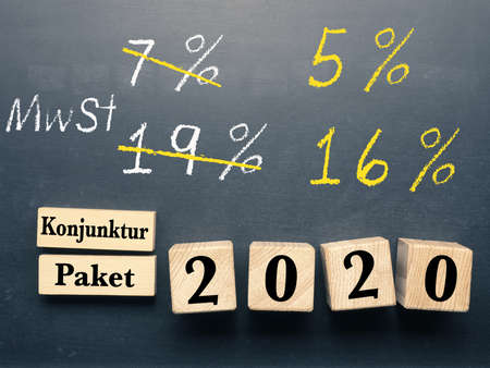 Conceptual image with wooden blocks on a chalkboard for economic stimulus package for Germany.