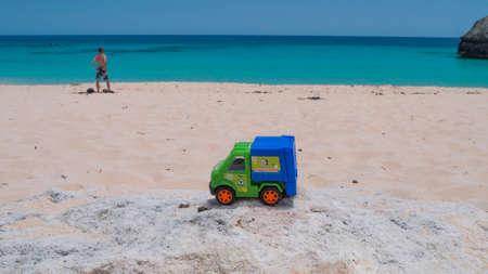 Toy truck on bermuda beach