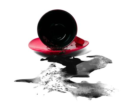 negligence: overthrowned red cup of coffee and black stain Stock Photo