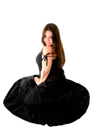 portrait of young woman in black dress sitting on the floor photo