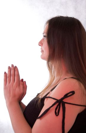 young woman with long brown hair praying to god photo