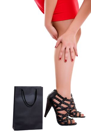 woman legs in high heels shoes and hand hold leg photo
