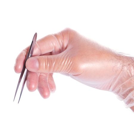 hand in rubber glove holding tweezers isolated on white photo