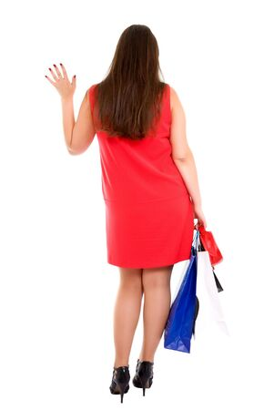 shopping woman with bags gives a wave goodbye Stock Photo