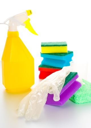 wet cleaning kit with yellow spray boottle, sponges and rubber gloves photo
