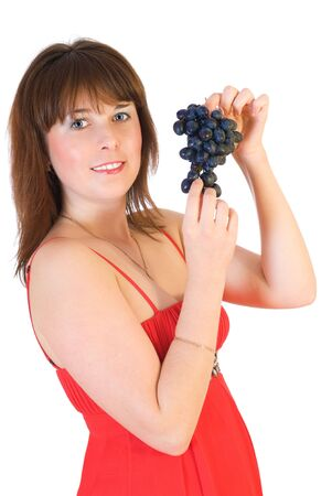 beautiful girl with black grapes in hand isolated on white Stock Photo - 5737123