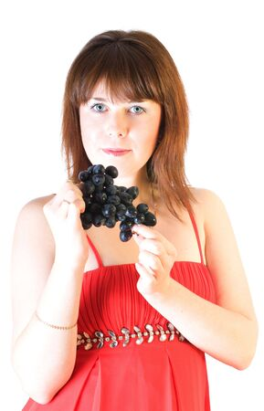 beautiful girl with black grapes in hand isolated on white Stock Photo - 5751548