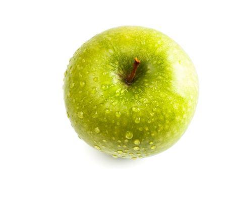 wet green apple isolated on white Imagens