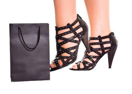 women legs in wreathy shoes kick shopping bag Stock Photo - 5920587