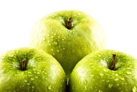 green apples with water drops isolated on white photo