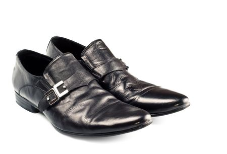 clasp feet: black male shoes with buckle isolated on white