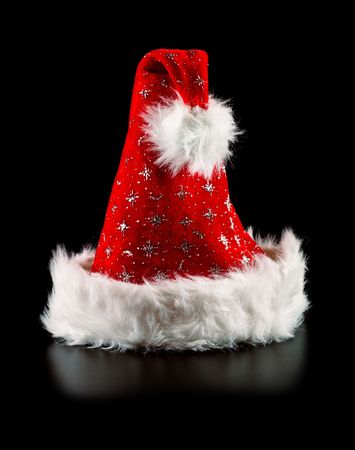 santa hat with stars isolated on black Stock Photo - 6101277