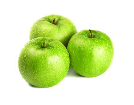 three green apples isolated on white photo