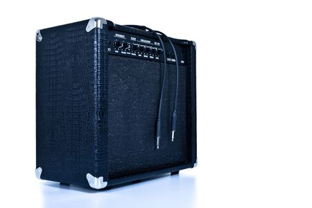 black guitar amplifier isolated on white, tinted photo
